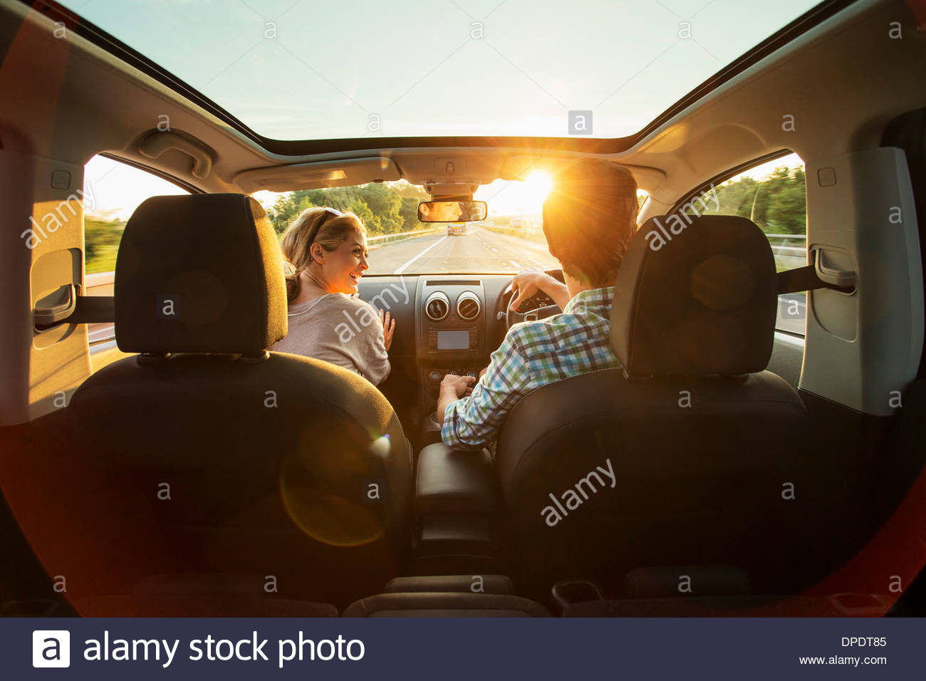 Young couple driving in car - Stock Image