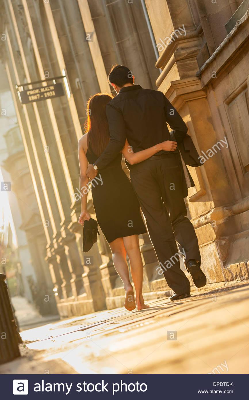 Couple walking on pavement, Birmingham, England, UK - Stock Image