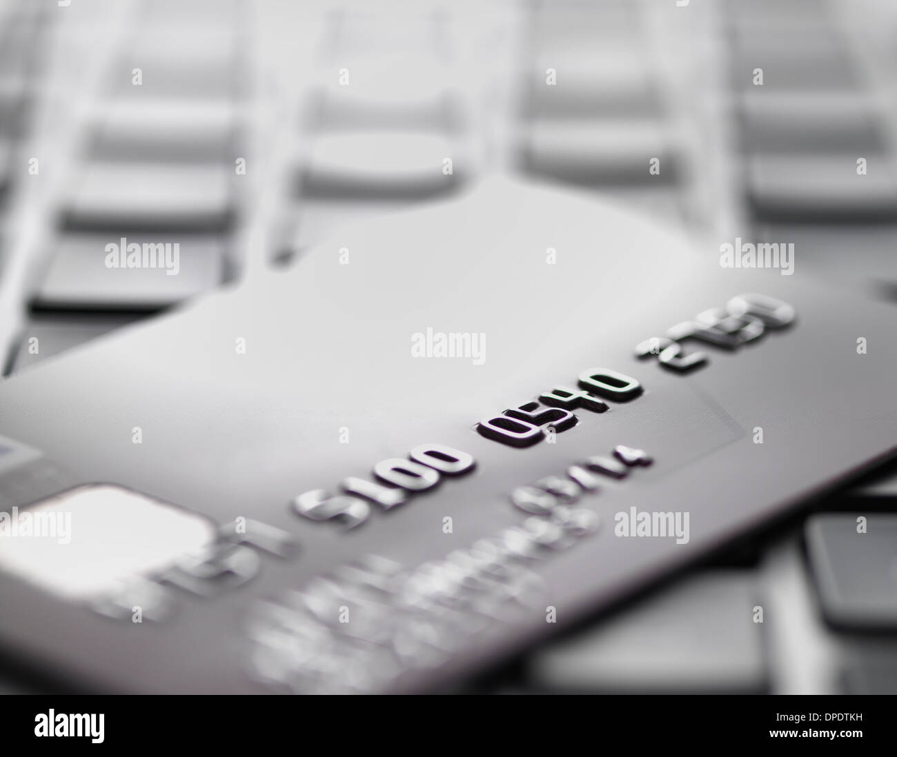 Credit card on laptop to illustrate internet shopping and internet fraud - Stock Image