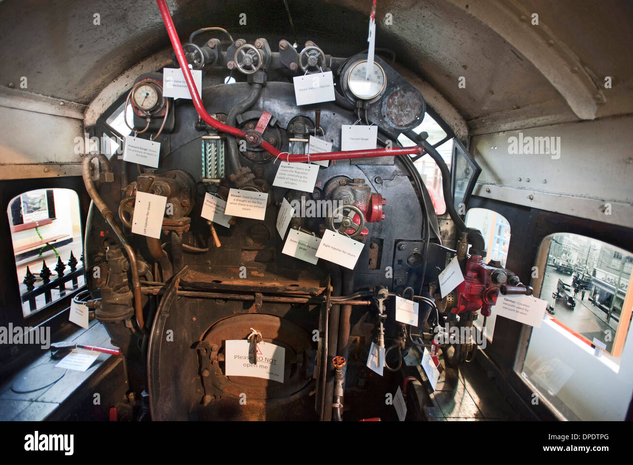 The Drivers Cab of a steam locomotive, with labels showing how to drive it. - Stock Image
