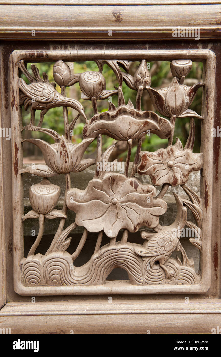 Wooden panel detail from the One Pillar Pagoda in Hanoi, Vietnam - Stock Image