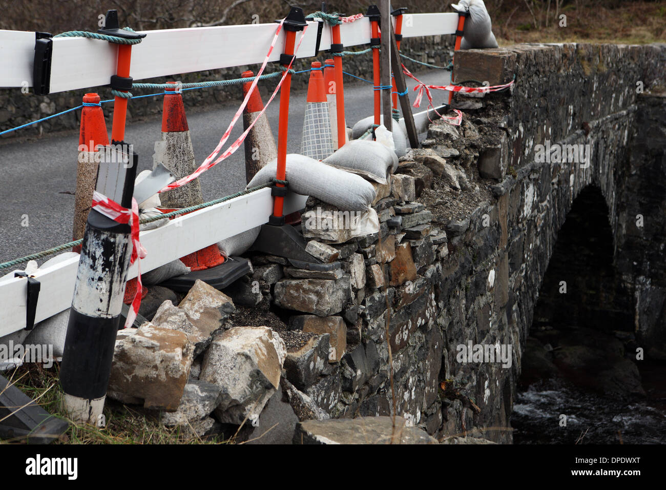 Traffic cones and tape covering a damaged bridge on an A road on the Isle of Mull - Stock Image
