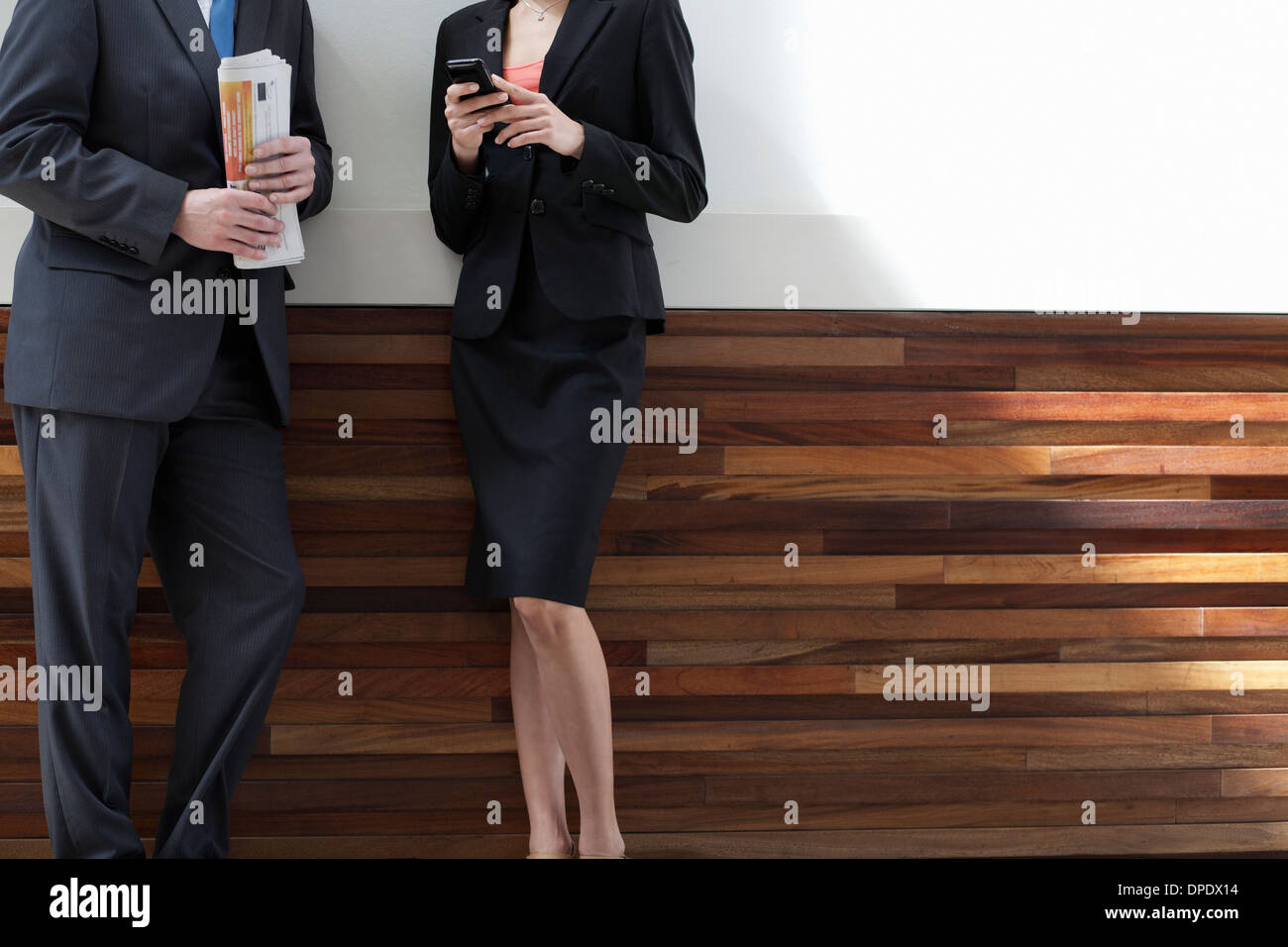 Businesspeople standing together Stock Photo
