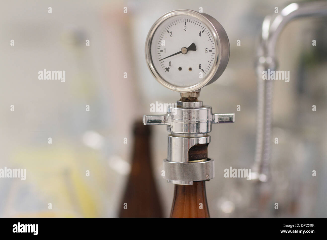 Pressure gauge in brewery - Stock Image