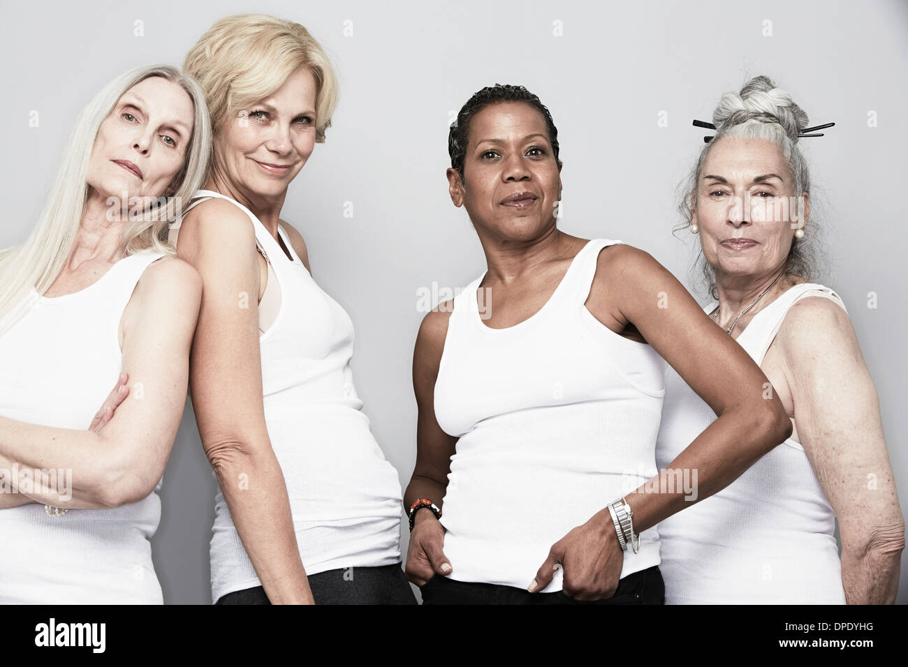 Studio portrait of senior women friends posing for camera - Stock Image