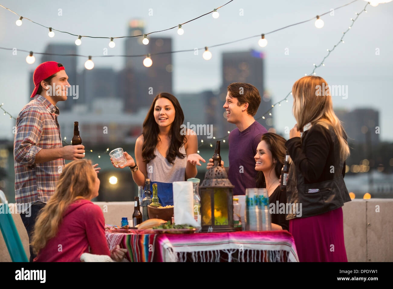 Young adult friends having fun at barbeque - Stock Image