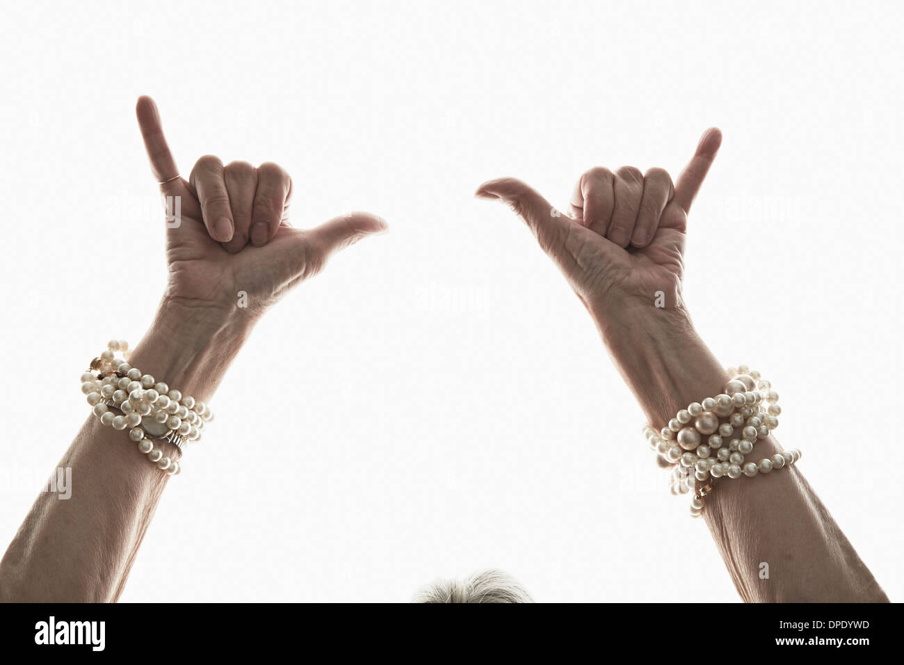 Studio shot of mature woman's gesturing hands - Stock Image