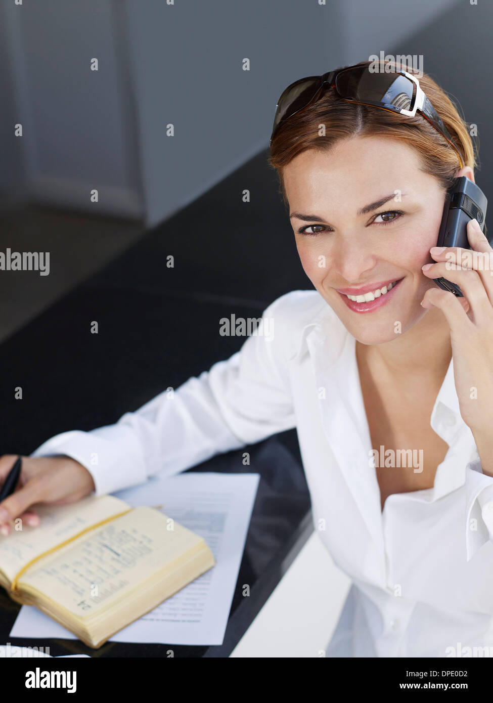Portrait of young businesswoman using mobile phone - Stock Image