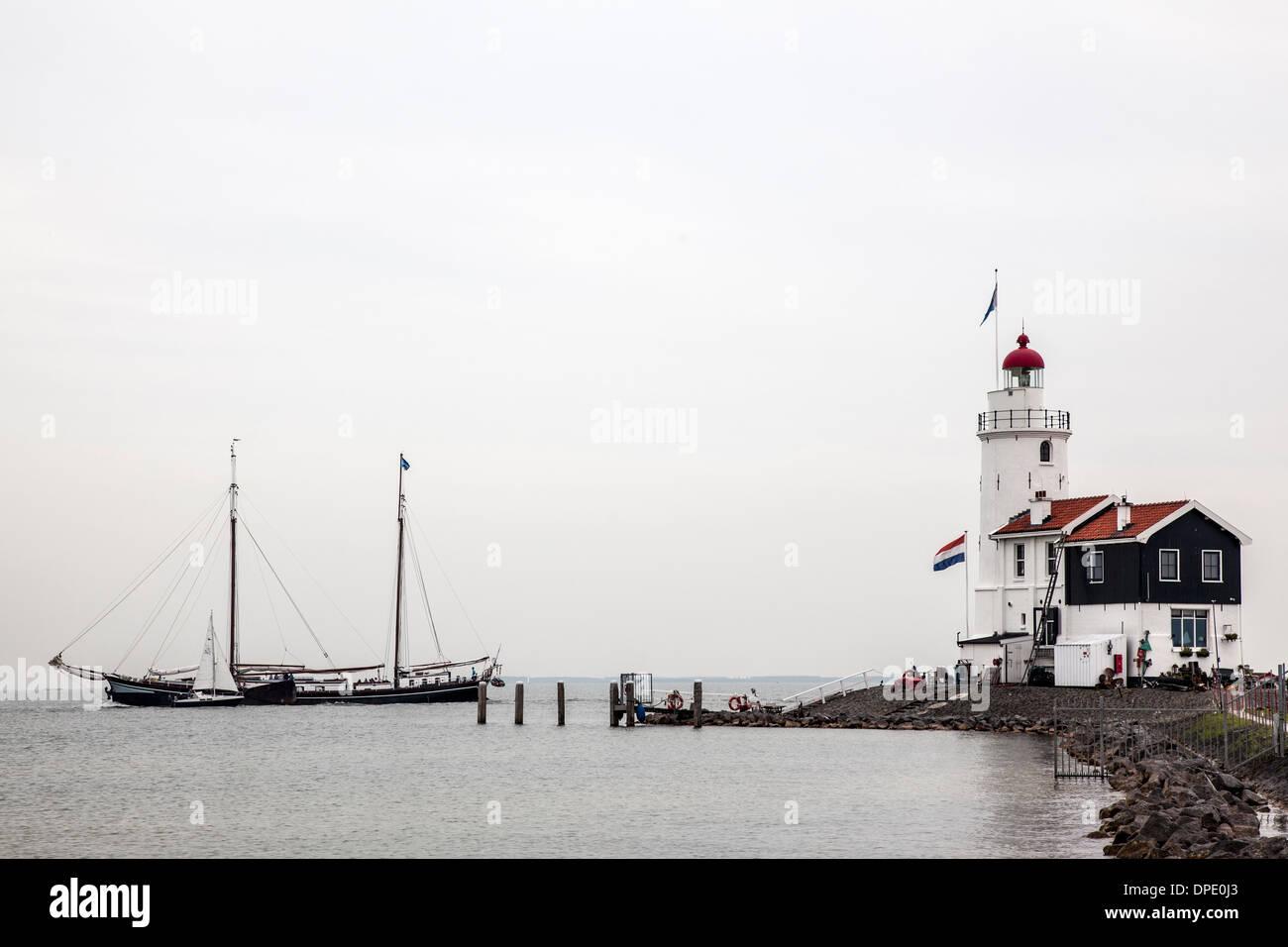 Lighthouse and sailing boats, Marken, Netherlands - Stock Image