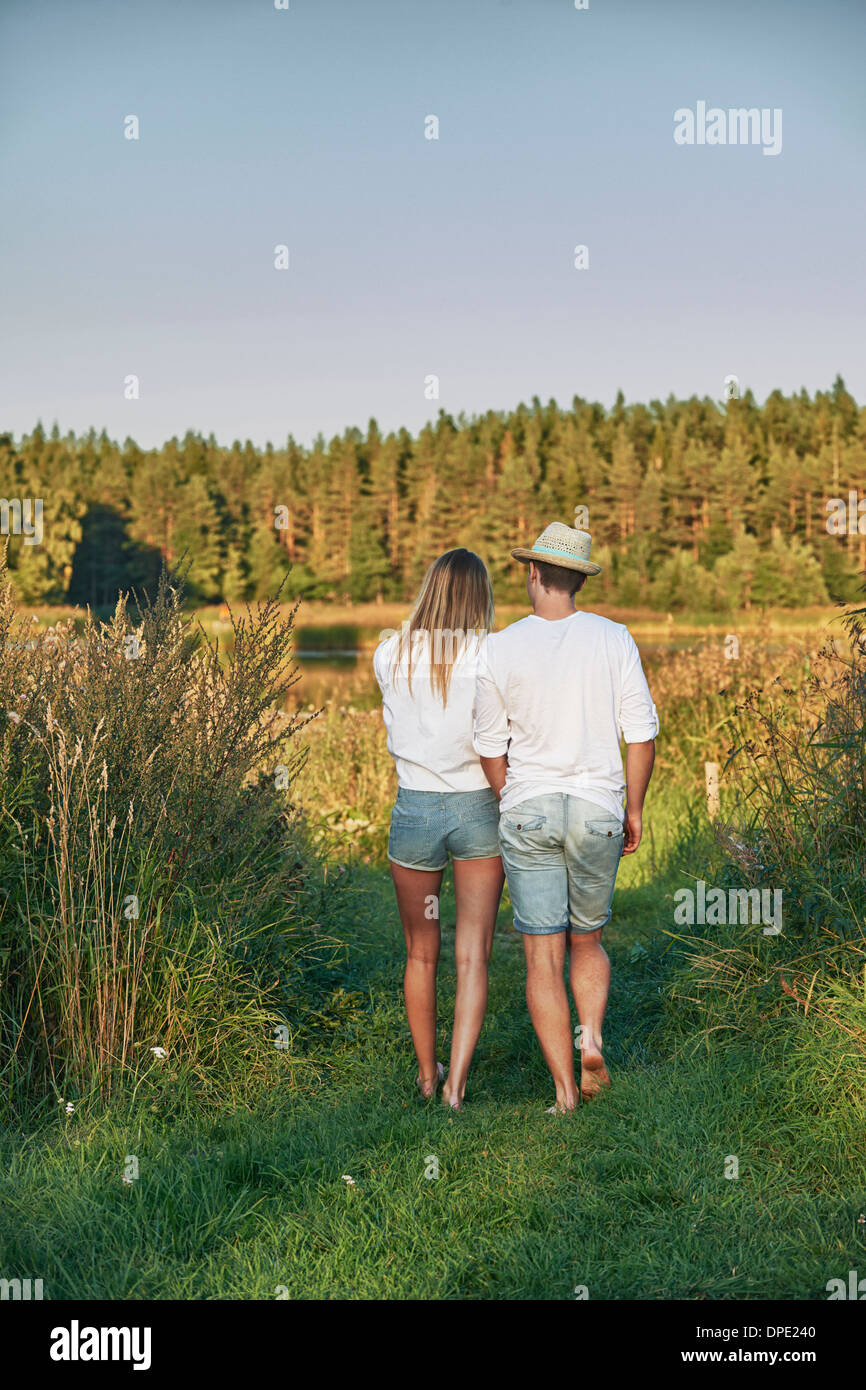 Romantic young couple strolling, Gavle, Sweden - Stock Image