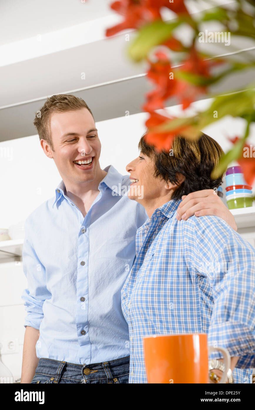 Adult grandson and grandmother in kitchen Stock Photo