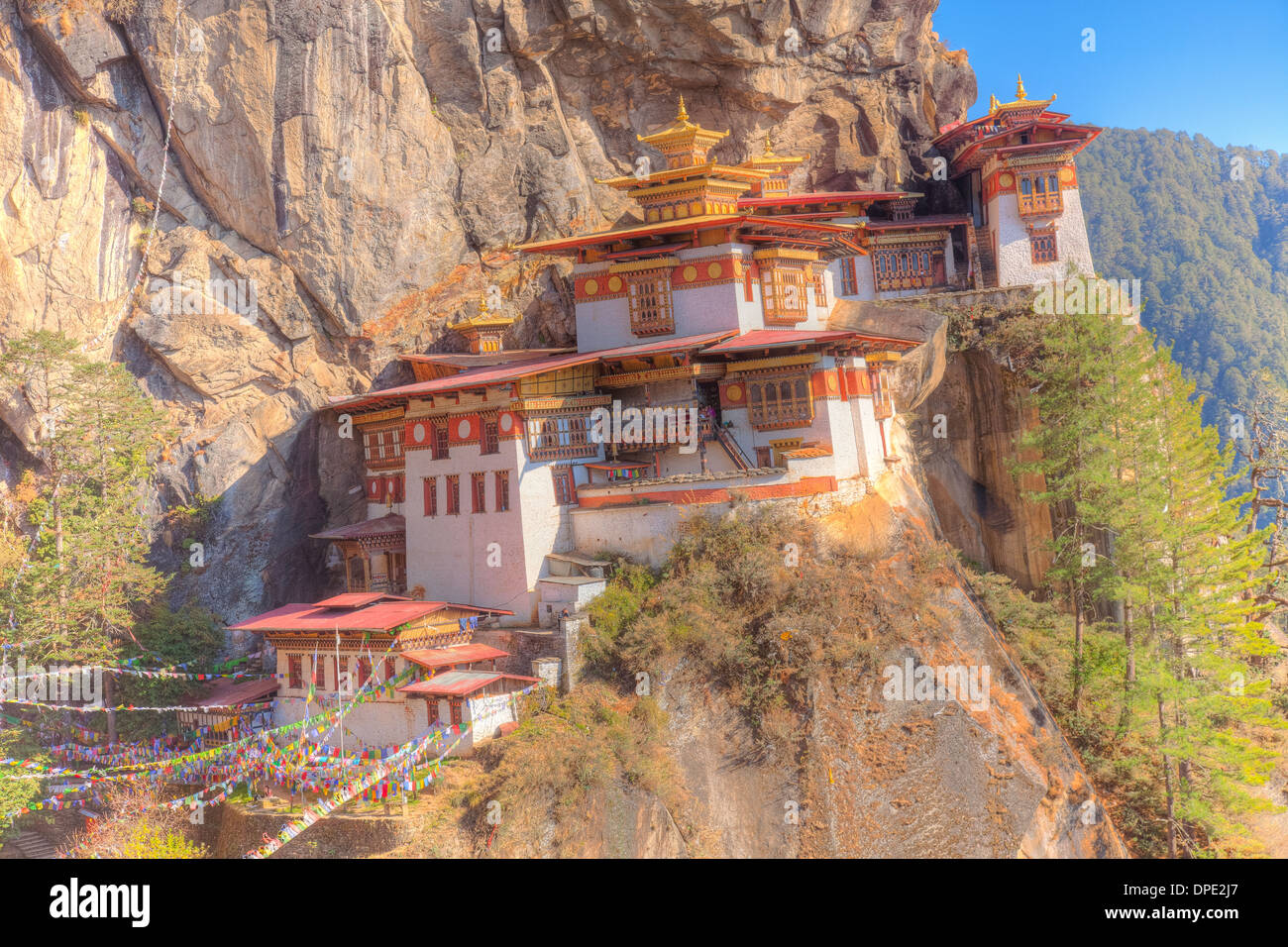 The Tigers Nest Monastery. Bhutan, Himalaya Mountains, Paro Valley. Taktshang Goemba. Perched 3,000 feet above valley below - Stock Image