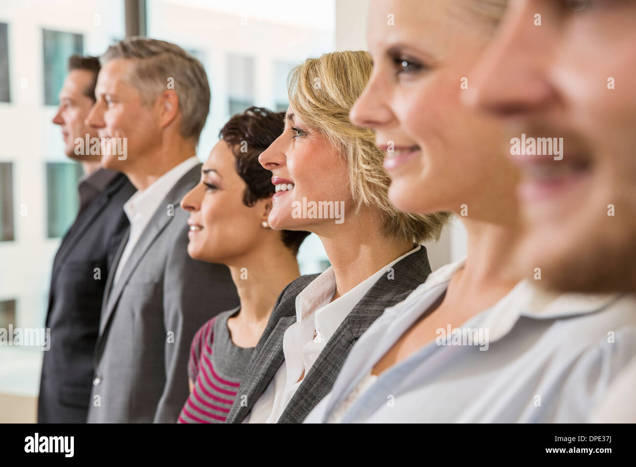 Businesspeople in a row - Stock Image
