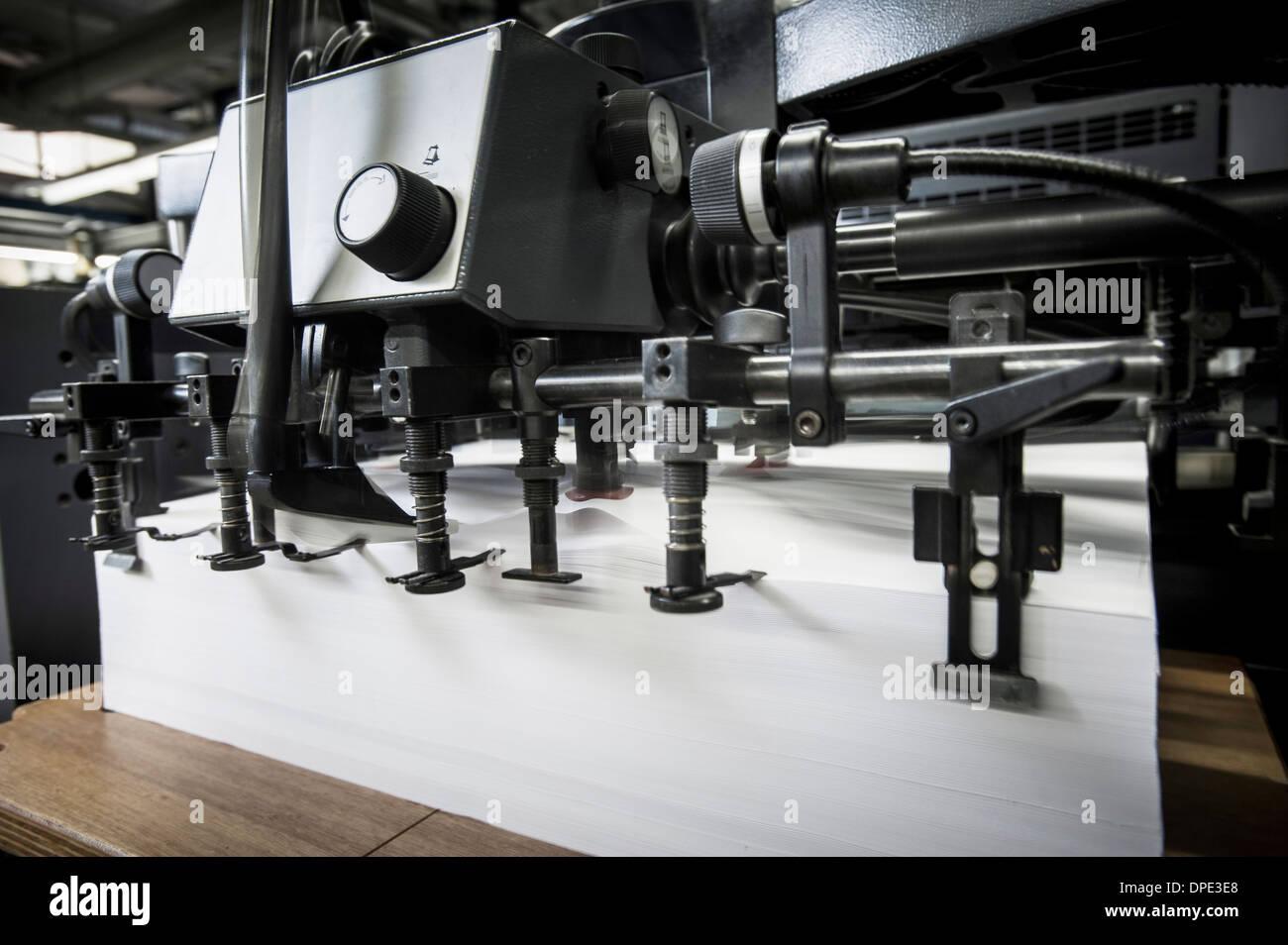 Paper prepared in printing machine in print workshop - Stock Image