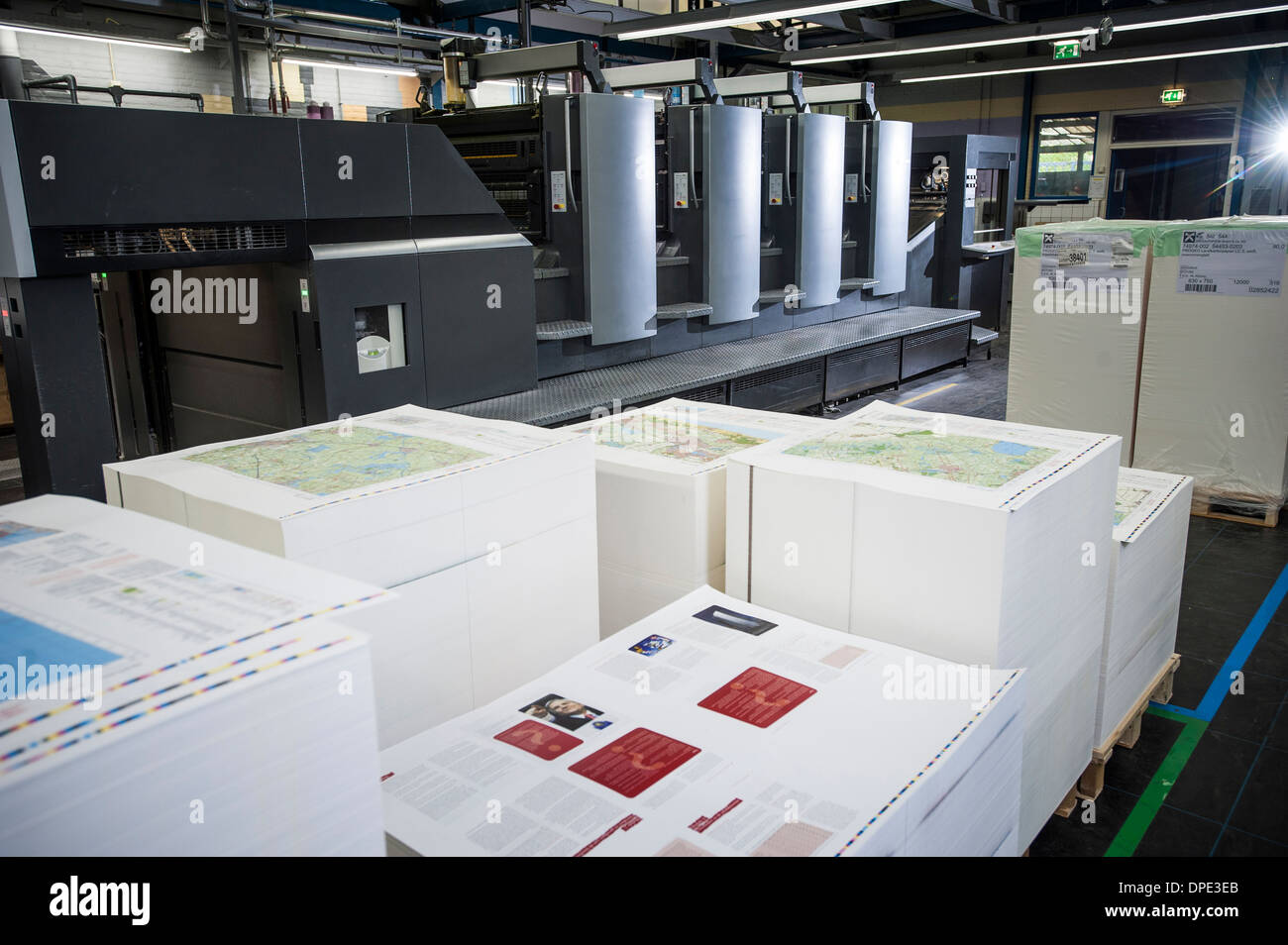 Pallets of finished printed products in paper printing warehouse - Stock Image