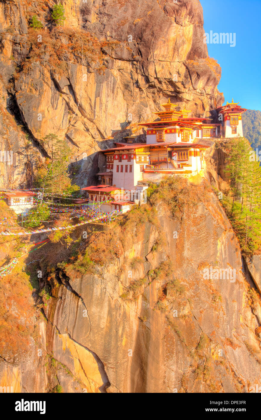 The Tigers Nest Monastery Bhutan, Himalaya Mountains, Paro Valley. Taktshang Goemba. Perched 3,000 feet above valley below - Stock Image
