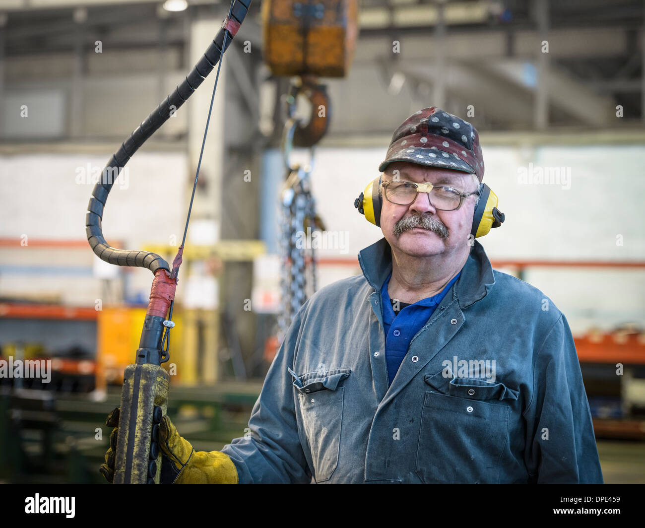 Portrait of crane operator in factory - Stock Image