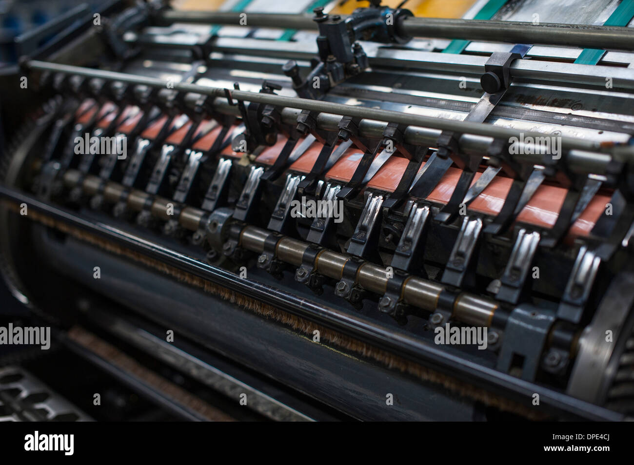 Close up of paper print machine in printing workshop - Stock Image