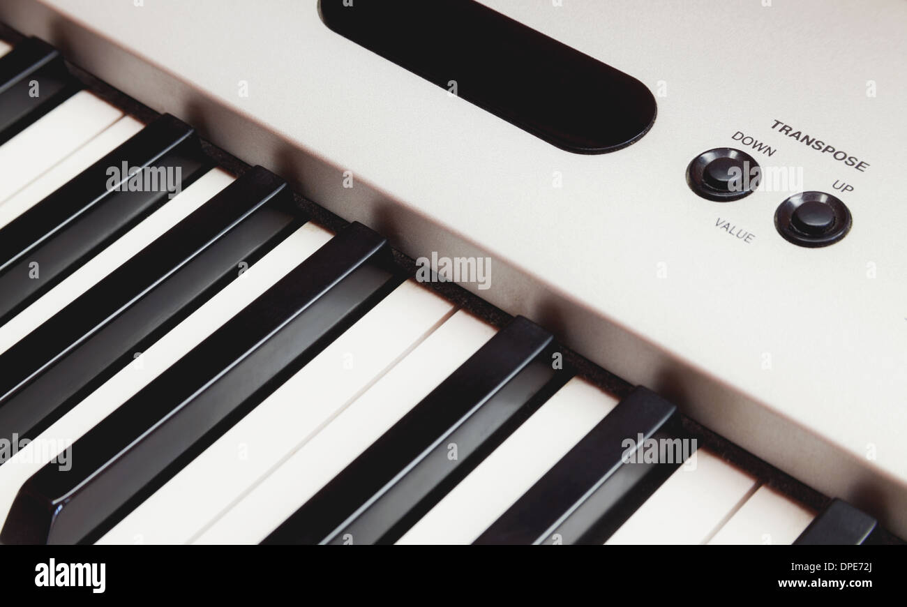 Part of electric piano, two keys for transpose, up and down. - Stock Image