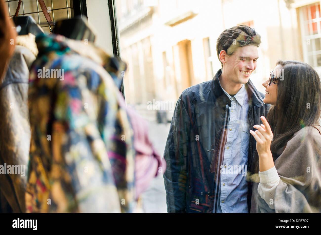 Young couple window shopping - Stock Image
