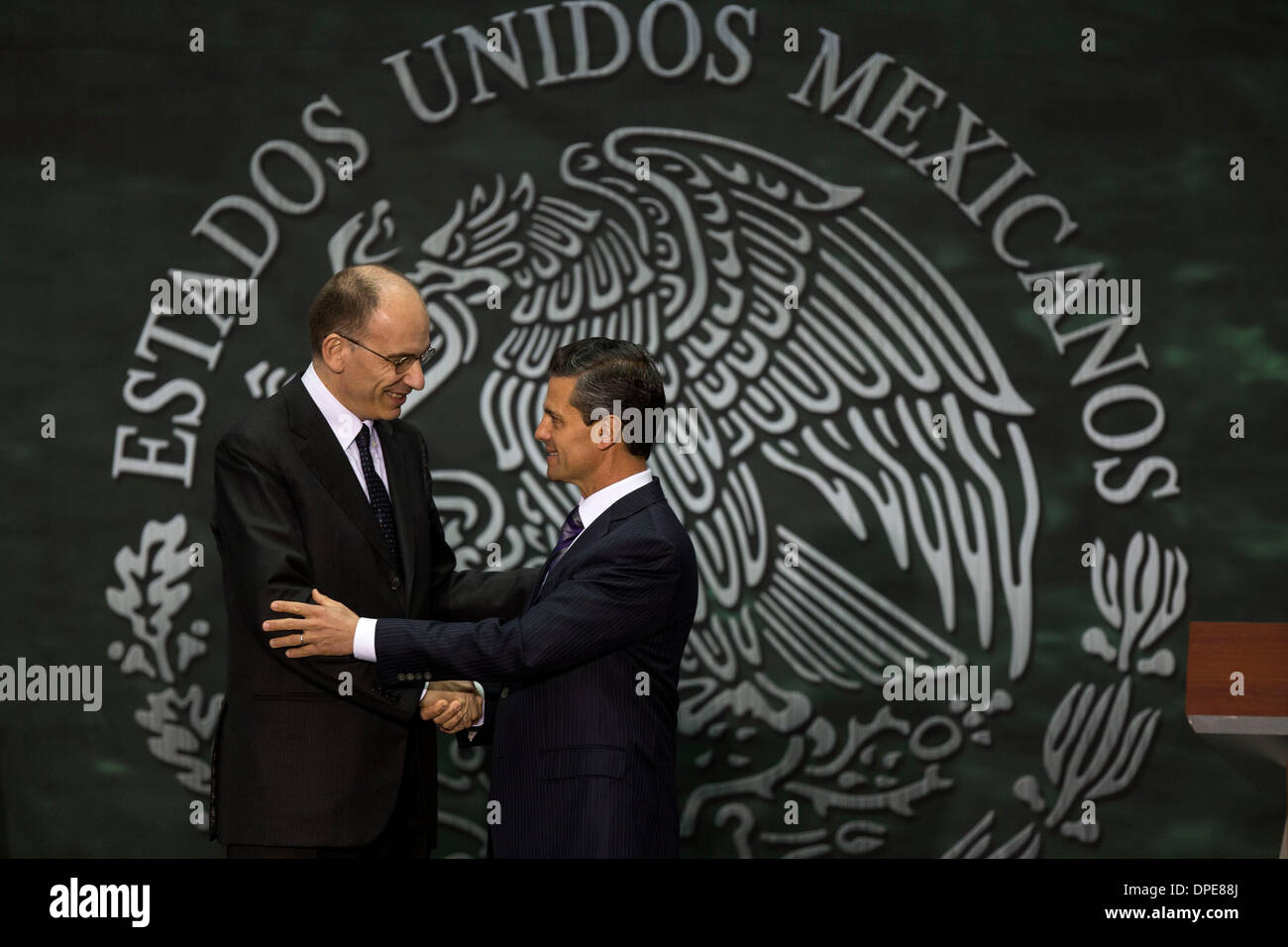 Mexico City, Mexico. 13th Jan, 2014. Mexican President Enrique Pena Nieto (R) shakes hands with Italian Prime Minister Stock Photo