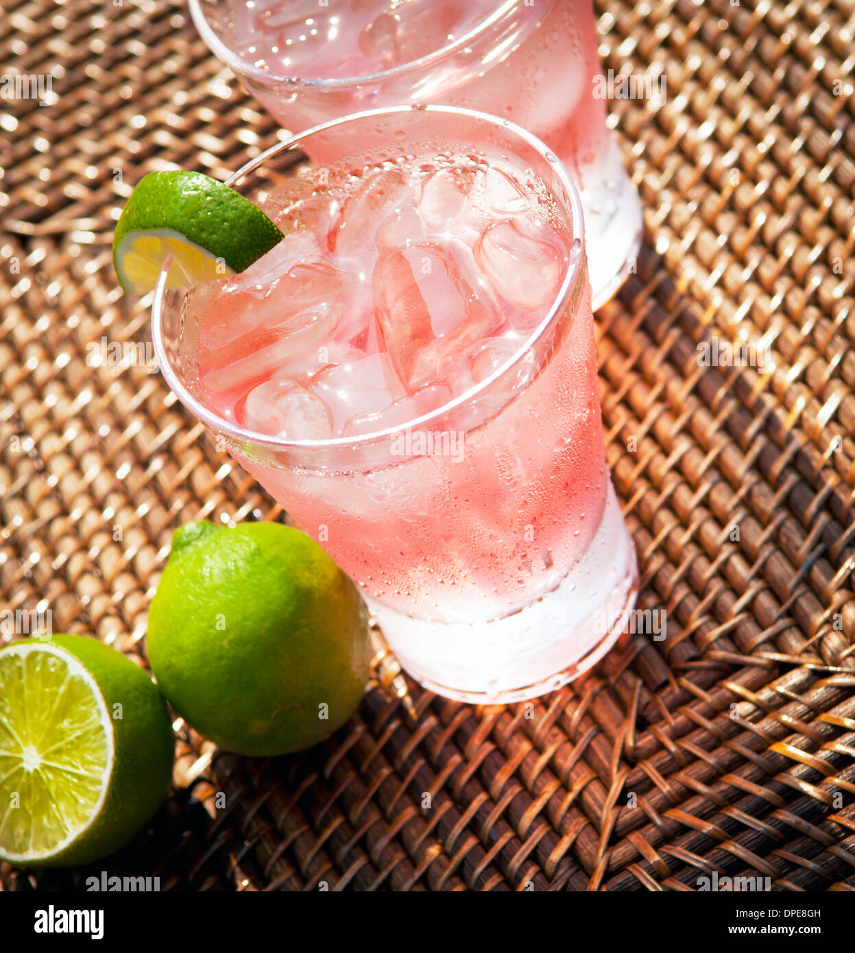 Pink Lemonade with Limes - Stock Image