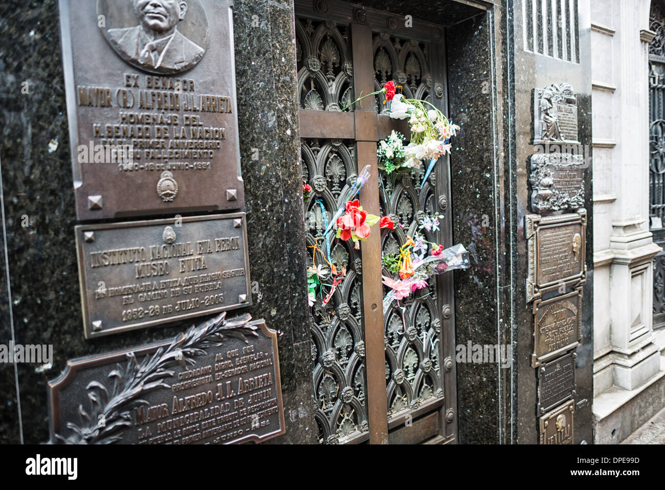 BUENOS AIRES, Argentina - Flowers left by visitors adorn the gravesite of Eva Peron, a former first lady of Argentina and beloved national figure. La Recoleta Cemetery is a famous cemetery in the Recoleta neighborhood of Buenos Aires and is famous for being the burial sites of Eva Peron, Argentinian presidents, and other notables. The cemetery features above-ground gravesites and crypts and is organized into a series of streets and boulevards. - Stock Image