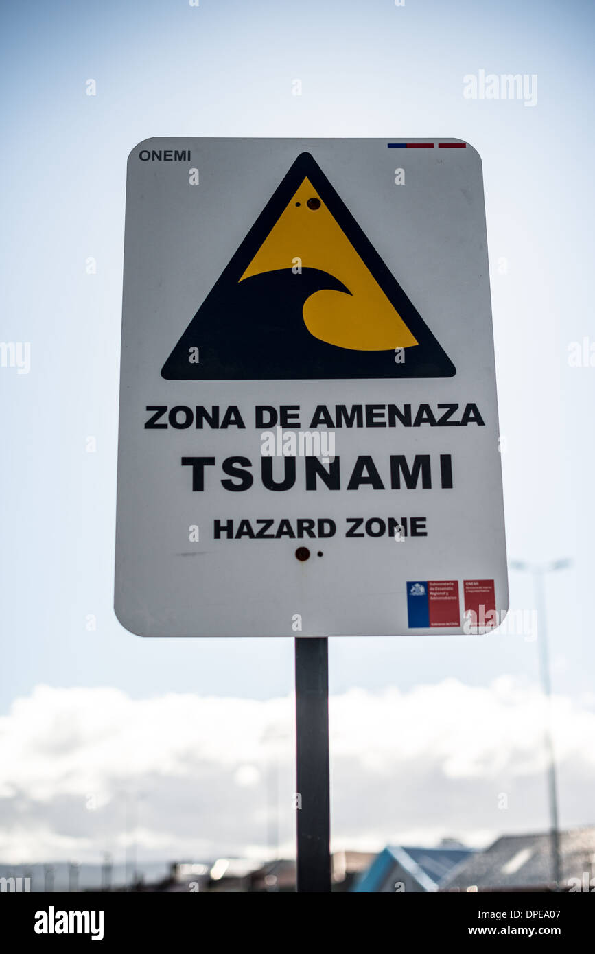 PUNTA ARENAS, Chile - A tsunami wawrning sign in Punta Arenas, Chile. The city is the largest south of the 46th parallel south and capital city of Chile's southernmost region of Magallanes and Antartica Chilena. - Stock Image