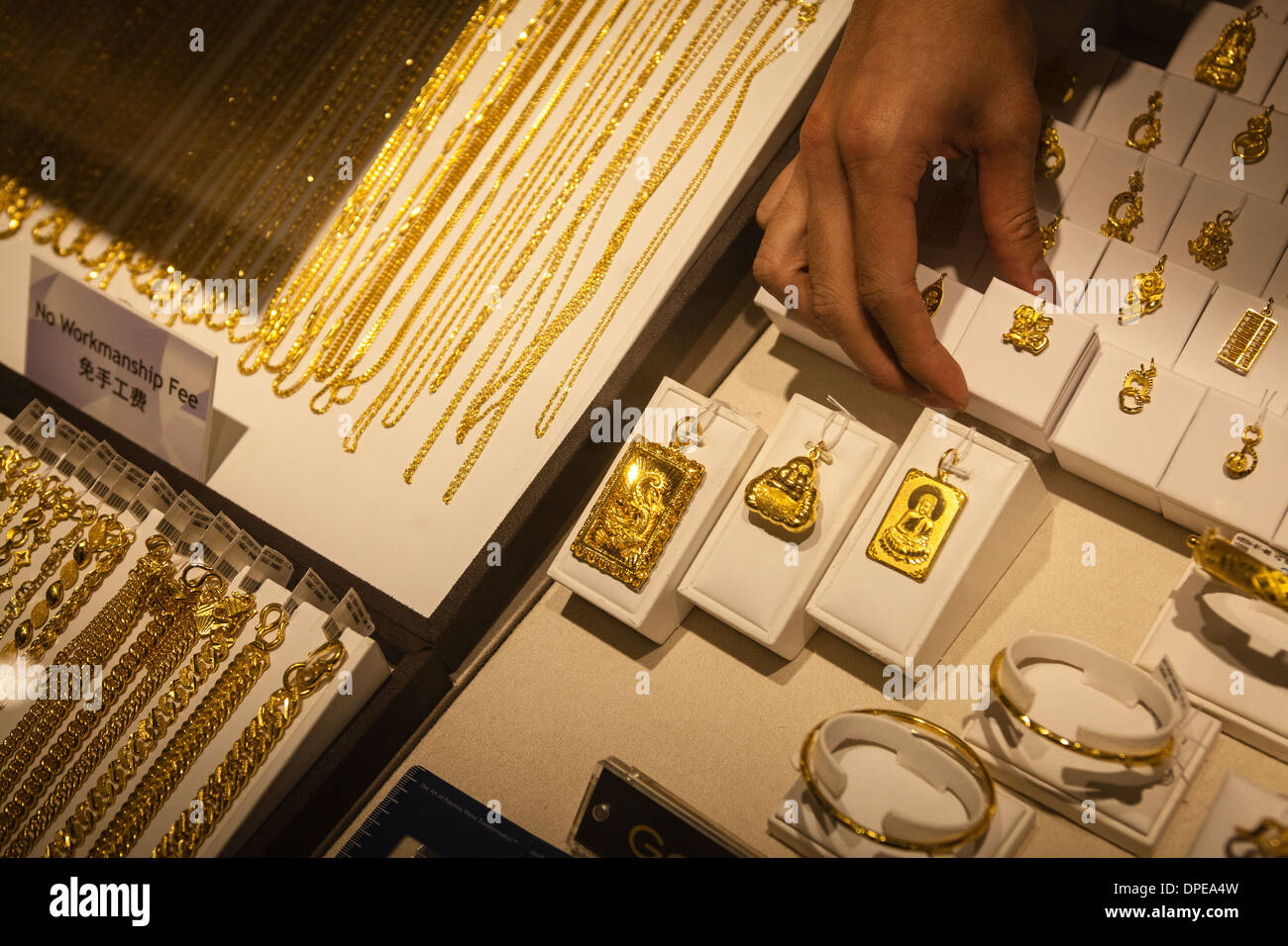 Gold jewellery on sale at a branch of Maxi-Cash pawn brokerage in Singapore - Stock Image