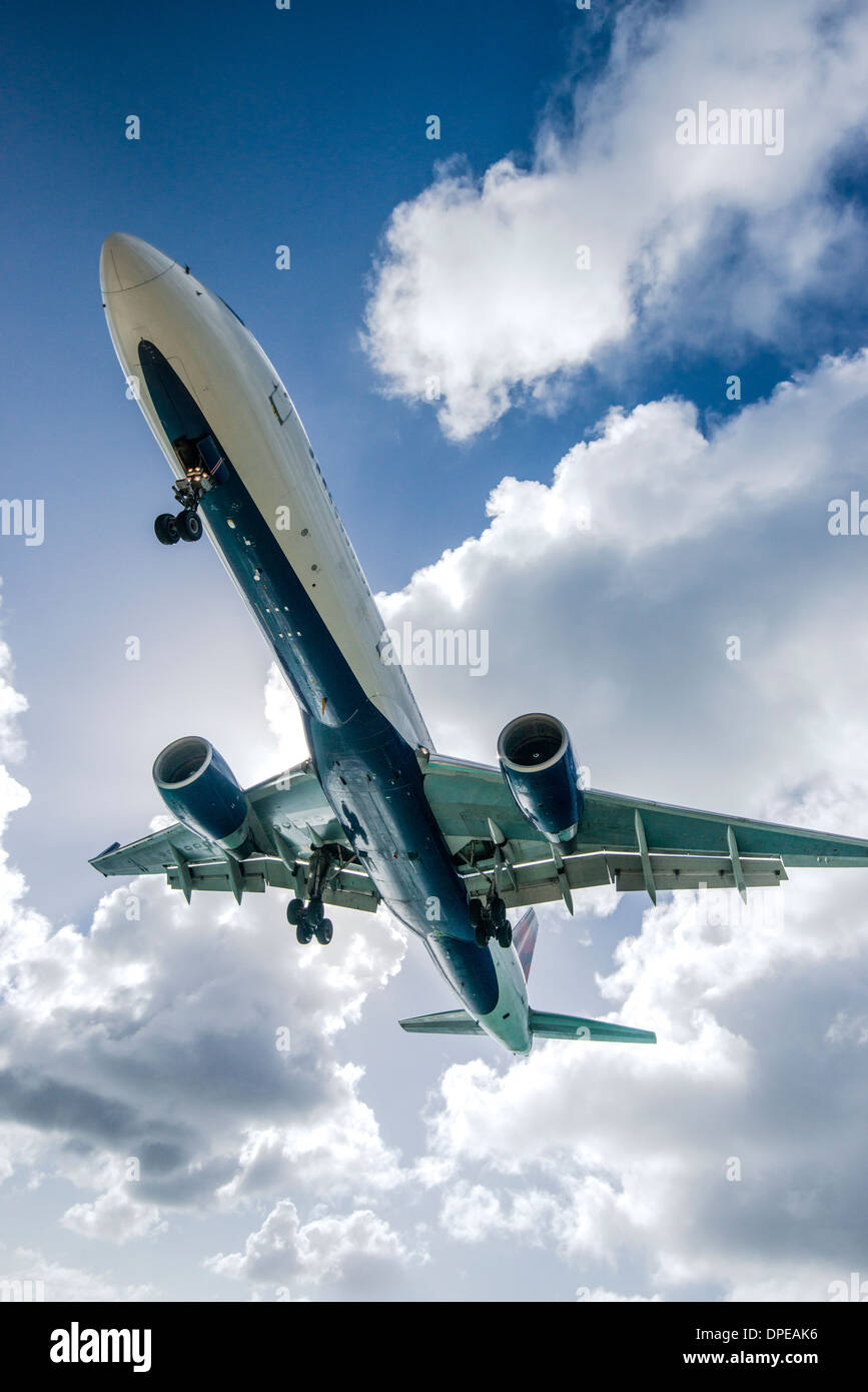 A commercial jet approaches Princess Juliana Airport. - Stock Image