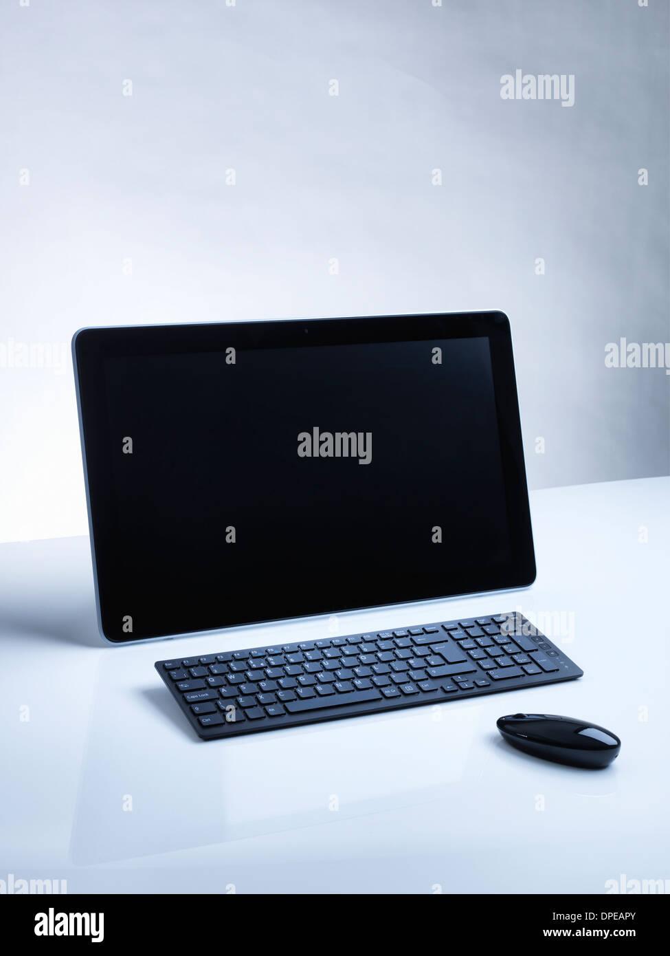 Computer on desk - Stock Image