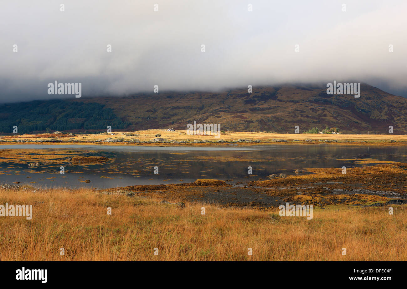 Low lying cloud obscuring Ben More on Mull from the banks of Loch Scridain near Kinloch on the Ross of Mull, Inner Hebrides - Stock Image