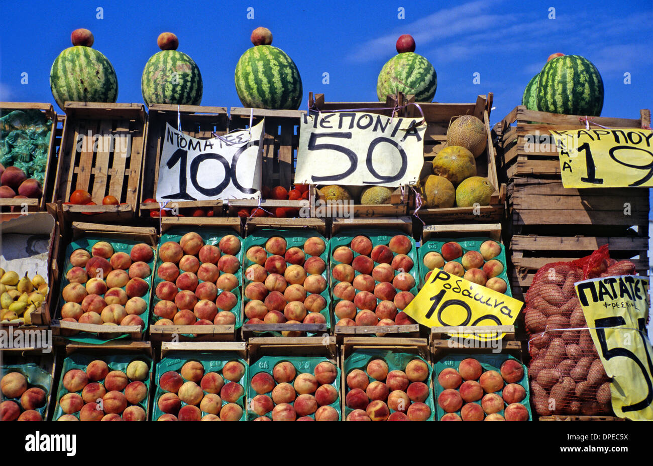 Display of Greek Fruit Peaches & Melons on Market Stall Priced in Drachma Greece - Stock Image