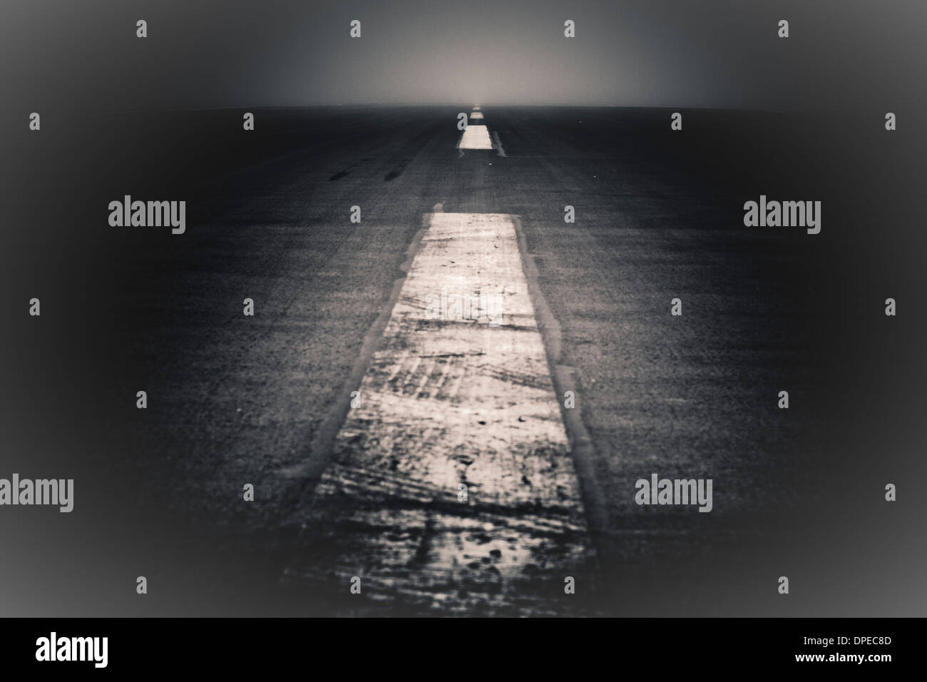 Abstract creative photo of dramatic dark road and sky. - Stock Image