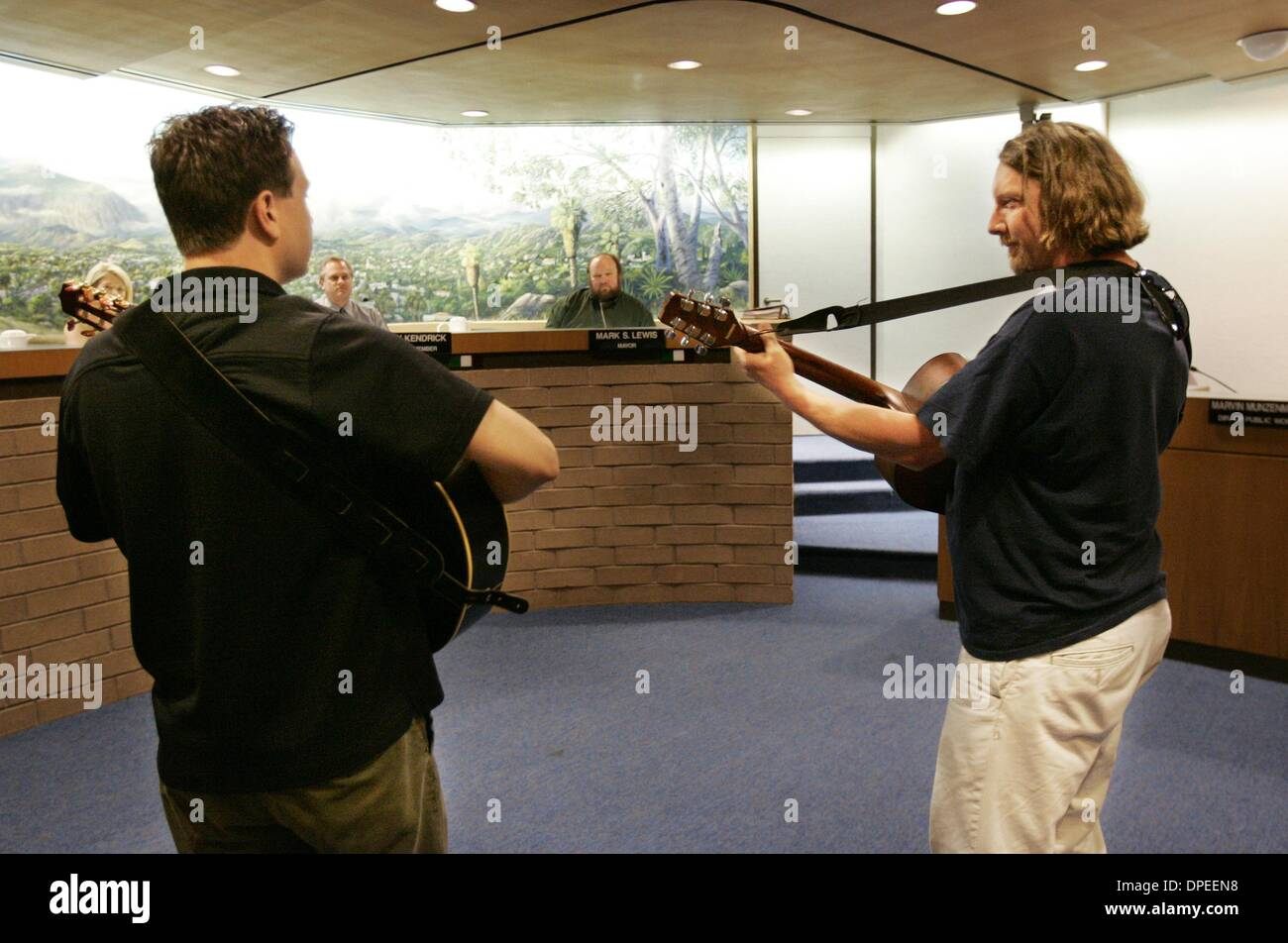 (Republished 1/27/2005, B-6:7)  (Published 1/26/2005, B-1:2)  Wes Elliott (left) and Ravi Laird (right), members of the group ''Tapwater'' serenade the mayor and city council of El Cajon during a session concerning the future of the East County Performing Arts Center in El Cajon.  Earnie Grafton/UT - Stock Image