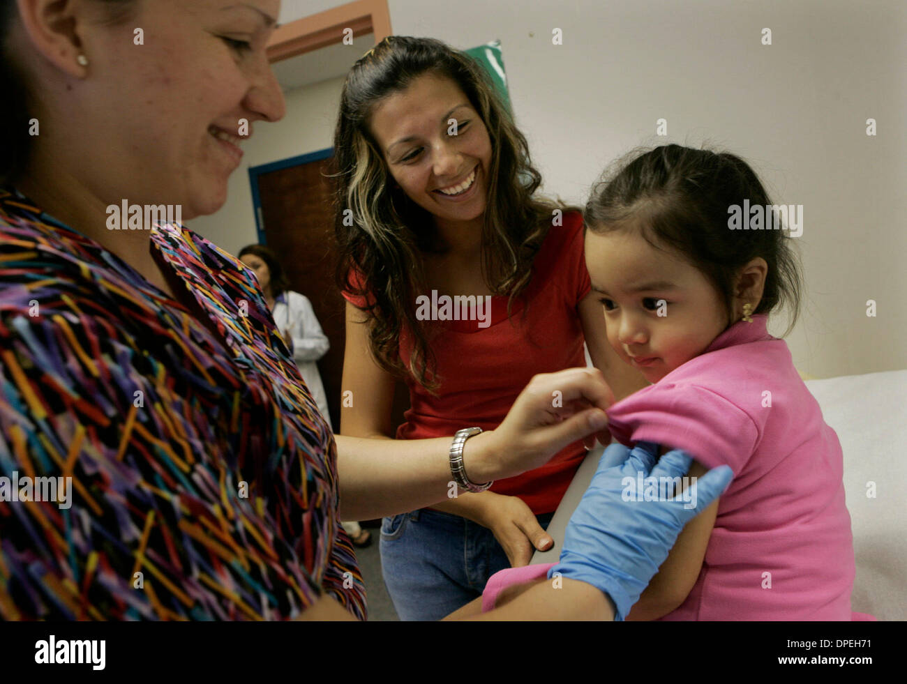 (Published 10/2/2005, Health & Wellness-4) Adriana Rucopo (cq), center, smiles at her daughter Camille Rico's - Stock Image