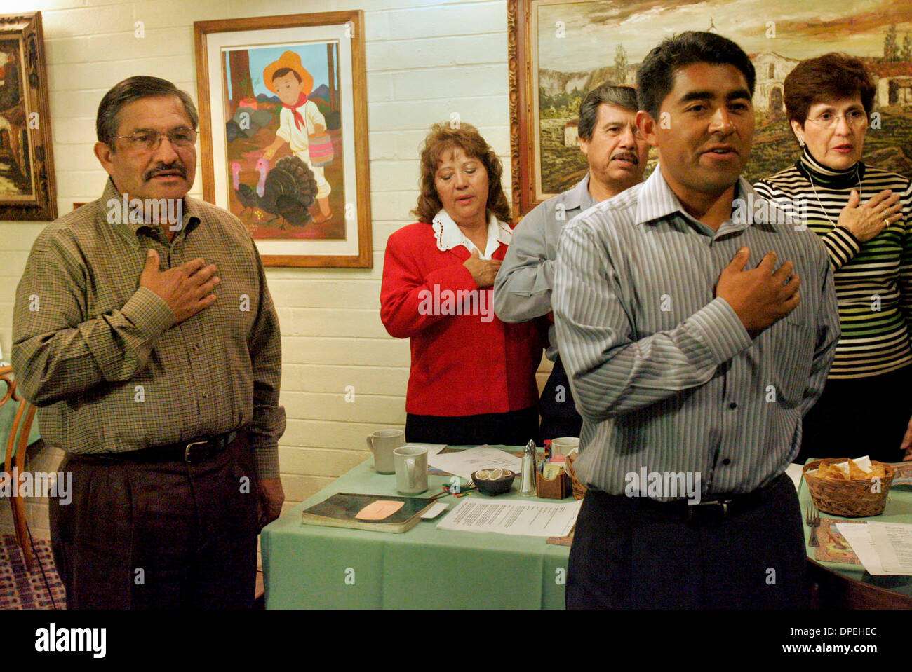 (Published 12/16/05, NC-1, Published 12/21/2005, NI-2) )Frank Lopez, left, lead the members of the Hispano Americans for Progress prior to the meeting.UT/DON KOHLBAUER - Stock Image