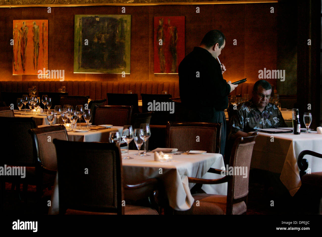 (Published 5/3/2006, E-3) April 18, 2006, San Diego, California, USA_Molly's Restaurant, in the Marriott Hotel and Marina, for the Dining Review. The meat dish is a Niman Ranch Pork Tenderloin with Anson Mills polenta, guanciale (cq), fava beans, mushrooms, port jus. The Spring Vegetable Tasting Platter has four items: baby carrots with marcona almonds, pea flan with a ring of carr - Stock Image