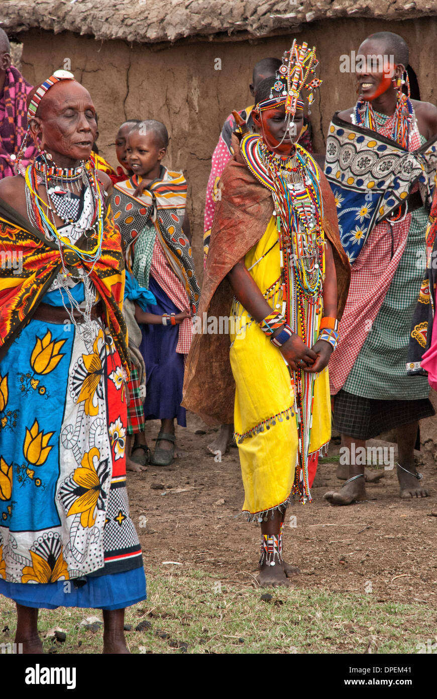 Bride attired in wedding dress, jewelry and facial color for an enactment of a Masai wedding in a Village, Masai Stock Photo