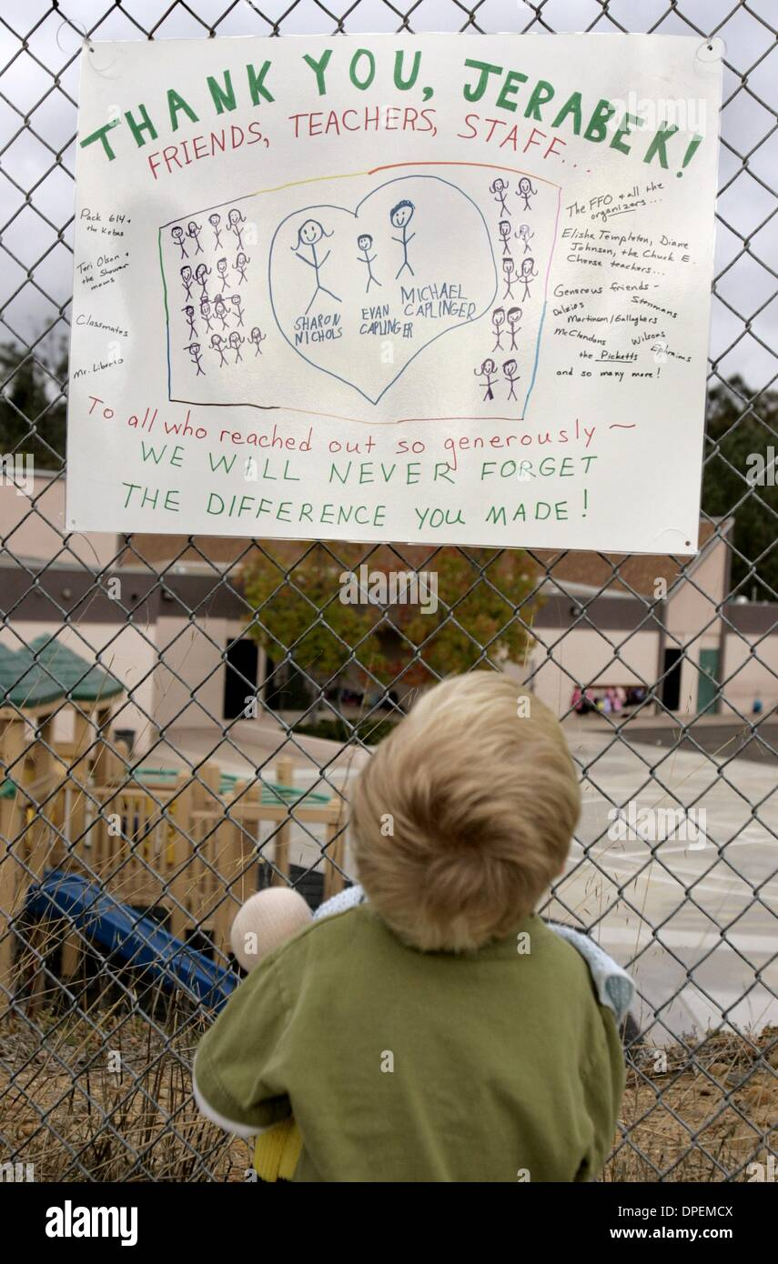 (PUBLISHED 10/27/2004, B-4:6)Joe Martinson (3) looked over one of the many signs that were hanging on the fence Stock Photo