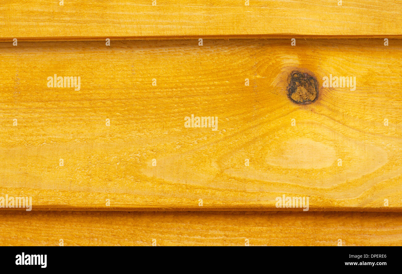 Background of rough planed planks painted in yellow - Stock Image