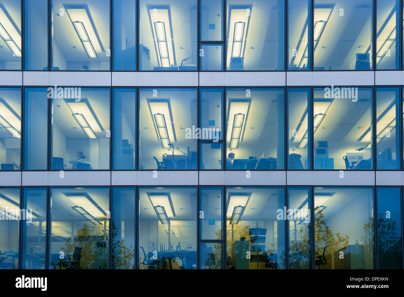office facade. Facade Of A Modern Office Building With Lights On In The Offices Evening, Munich, Bavaria, Germany T