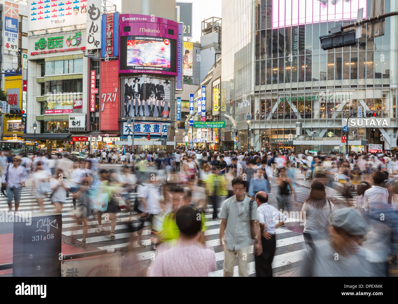People capture with motion blur in the world famous Shibuya crossing in Tokyo, Japan - Stock Image