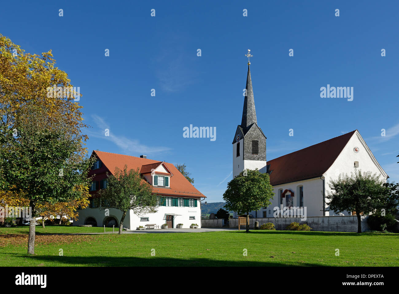 Local history museum and the parish church of St. Ambrose, Hergensweiler, Swabia, Bavaria, Germany, - Stock Image