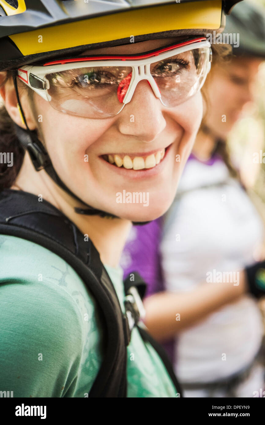 Portrait of female cyclist wearing cycling glasses - Stock Image