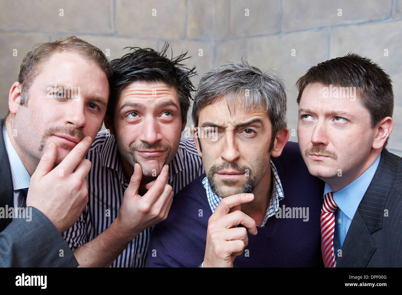 Hotel and restaurant staff in Oxford show off their moustaches grown for charity as part of Movember - Stock Image