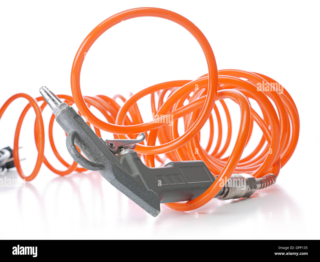 Air compressor gun with coiled orange hose shot on white - Stock Image