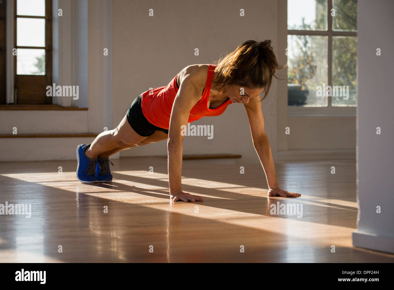 Woman in plank position - Stock Image