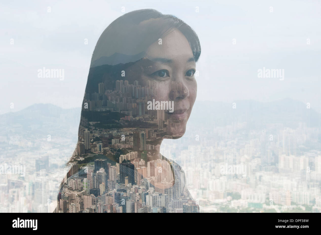 Businesswoman and Hong Kong cityscape, composite image - Stock Image