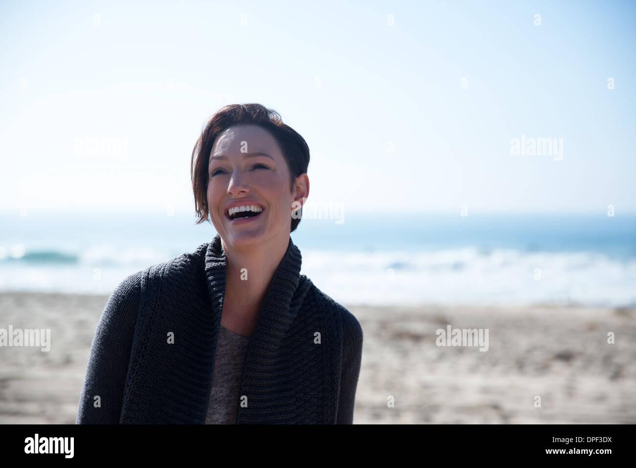 Mature woman on Newport Beach, California, USA - Stock Image